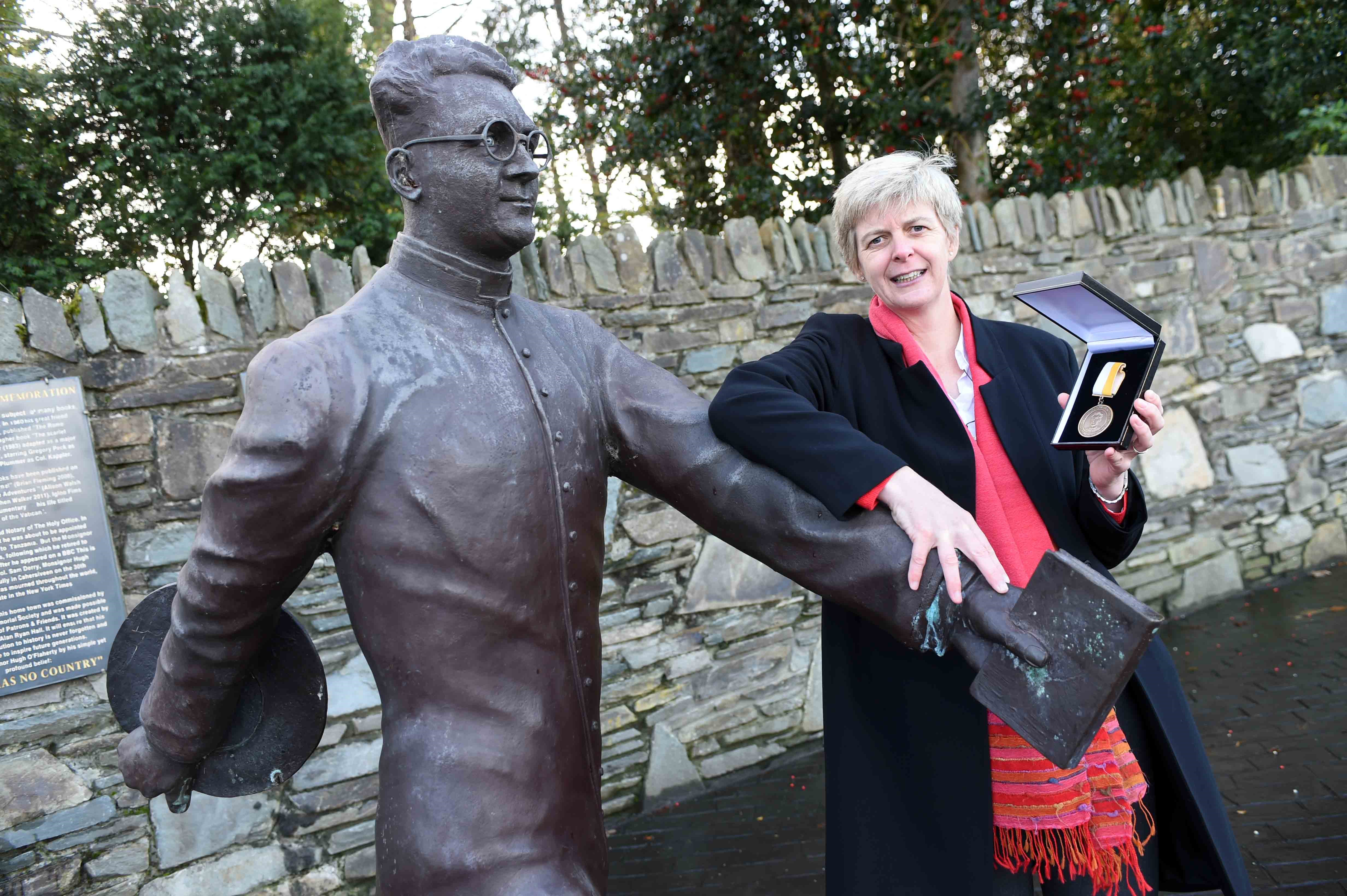 """5-11-2017: SR ORLA TREACY RECEIVES O'FLAHERTY HUMANITARIAN AWARD 2017: Sr. Orla Treacy from Bray, County Wicklow pictured in Killarney on Sunday after receiving the 2017 Hugh O'Flaherty International Humanitarian Award. This is the tenth year of this Award, established in 2008 to commemorate the humanitarian work of Killarney native Monsignor Hugh O'Flaherty, in Nazi occupied Rome during WW2.  Photo: Don MacMonagle  Sr Orla is the Principal of a Loreto education and medical mission in Rumbek, South Sudan. In 2004, the Loreto Sisters in Ireland and worldwide started a new movement called 'Courage to Move.' It was an invitation for all Loreto Sisters in different countries to start a new mission, to re-engage with missionary spirit that was reflected in the early foundations, and to try to start a new mission in new countries. Shortly after she was professed as a Loreto Sister, Sr Orla responded to this call and in 2006 travelled to Sudan. In the face of abject poverty, civil war and the absolute oppression of women and in particular young girls, they succeeded in establishing schools and a basic medical centre in the area of Rumbek in central South Sudan.    In accepting the Award, Sr Orla told the large audience, """"In 2011, South Sudan gained independence and it was hoped that matters would improve.  Following a brief period of relative peace, conditions in South Sudan have returned to those applying pre-Independence and the Loreto Sisters continue to struggle to provide education and minimal medical care for those in their care"""".   She went on to describe the terrible circumstances facing young girls in South Sudan, with forced marriages while still in their teens, high mortality in childbirth and almost non-existent education, even at primary level.   Concluding on a positive note, she added, """"The Loreto sisters are committed to staying the course and with the help of supporters in South Sudan and at home in Ireland, we will continue to do everythin"""