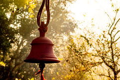 hindu-prayer-bells-remote-temple-forest-bokeh-trees-golden-sunlight-morning-sun-81494949[1]